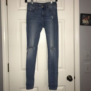 American Eagle skinny jeans with holes in knees